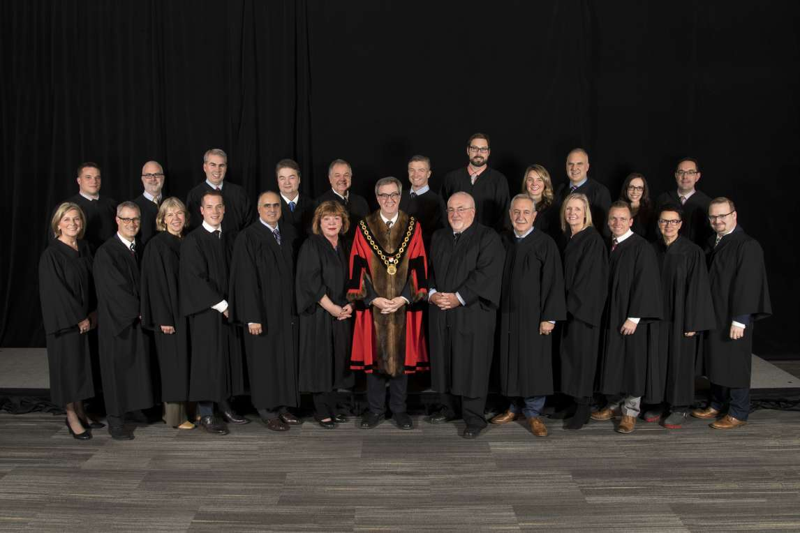 Family photo of 2018 City Council members in black robes