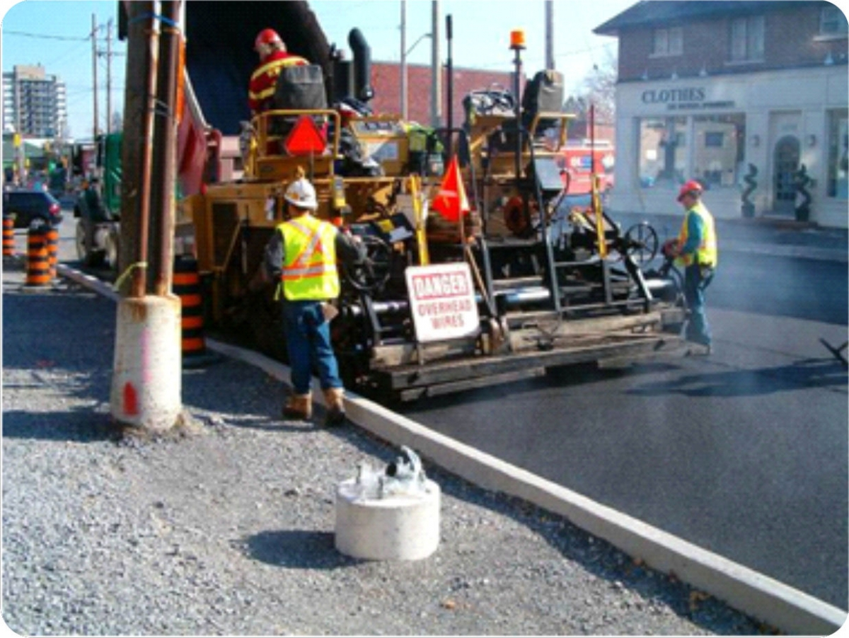 Photograph of a construction crew working on another street