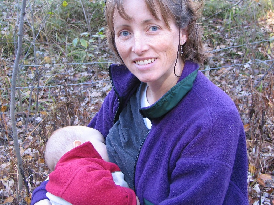 A woman breastfeeding while outdoors