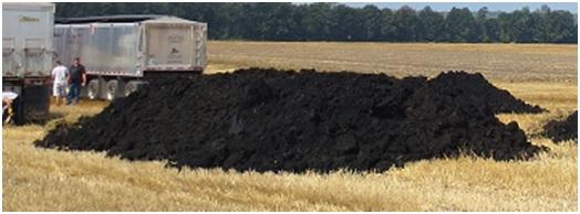 Biosolids in a field before application