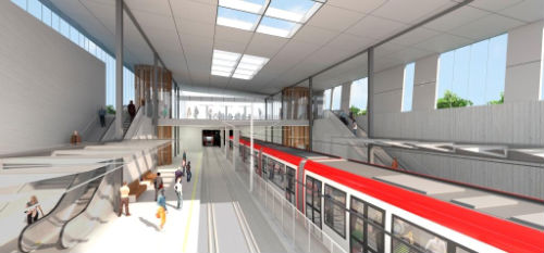 The inside of the station will provide an airy and light feel, with a double height space over the tracks and platforms to the east of the actual entry area. We can see this entry area mezzanine in the background, spanning over both tracks and connecting to the stairs and escalators connecting to the platforms.