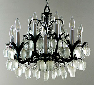 Detail of a chandelier with hanging bats made of cast beet sugar created by Karen Abel.