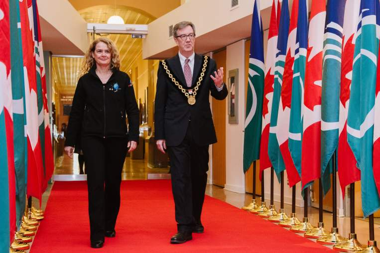 Governor General Julie Payette and Mayor Jim Watson walking down red carpet