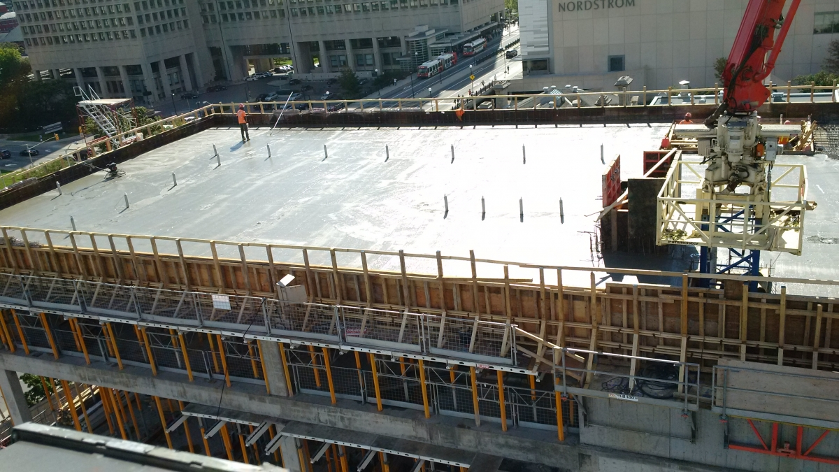 View looking down on the roof for the new Ottawa Art Gallery. The freshly poured concrete shines in the sun.
