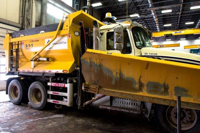 Image of snow plow indoors displaying new sideguard.