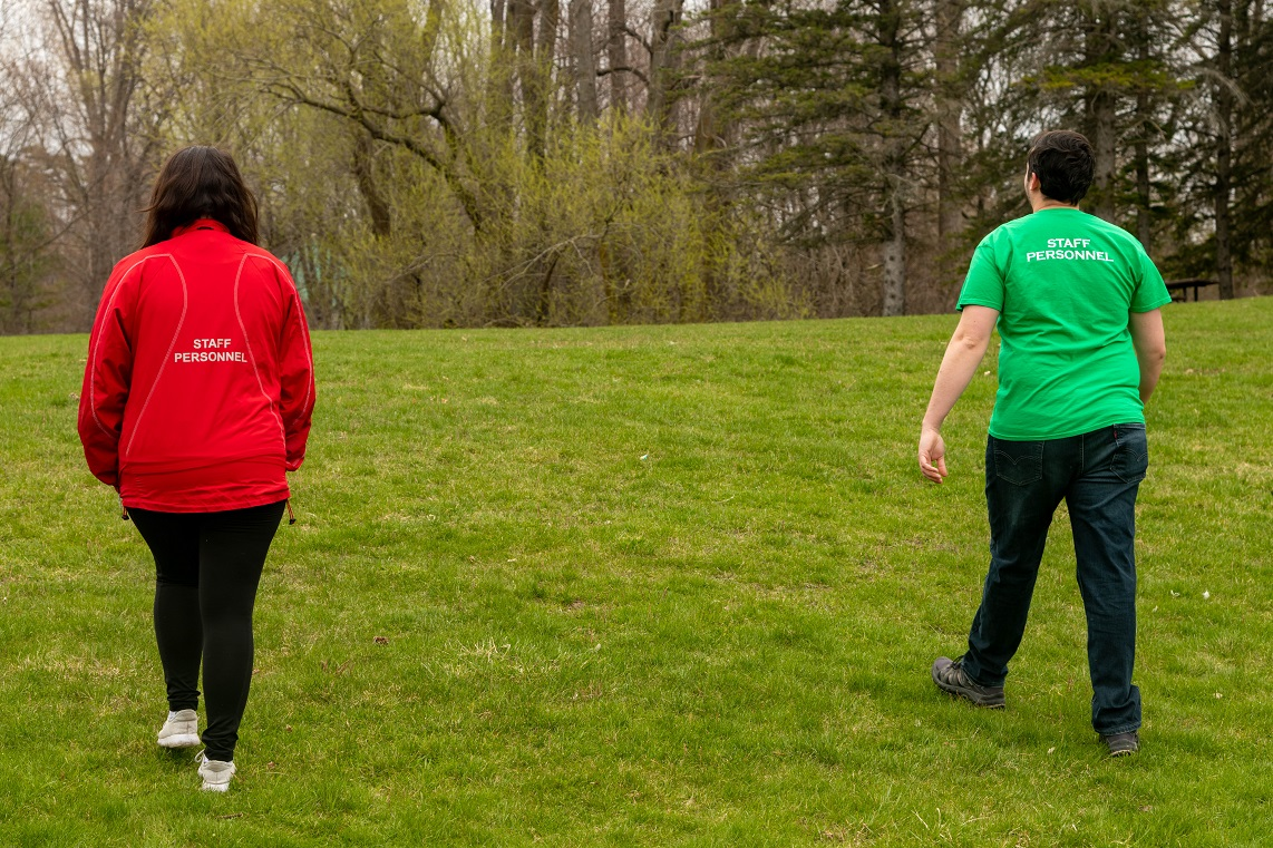 Man in green t-shirt and woman in red jacket
