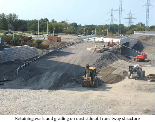 Retaining walls and grading on east side of Transitway structure.