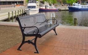 A black bench with three arm rests