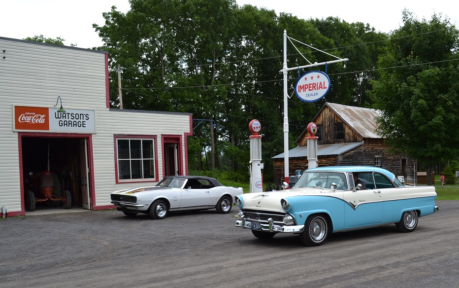 classic cars at a gas station