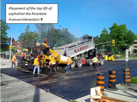 the placement of the top lift of asphalt at the Riverdale Avenue intersection.