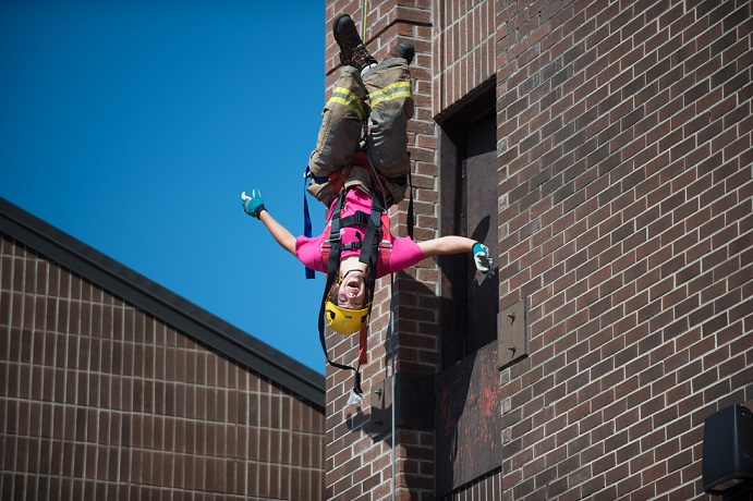 Camp FFIT student hanging upside down