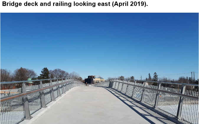 Bridge deck and railing looking east (April 2019).