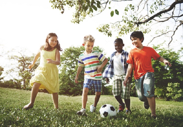 Four kids playing soccer