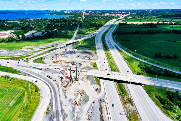Aerial photograph of the construction of the future Moodie Station with Highway 417 to the right and Moodie Bridge towards the bottom of the picture.