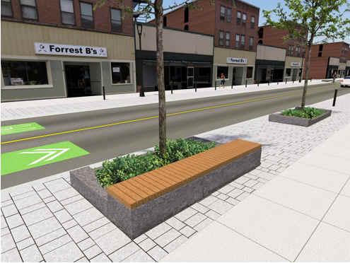 des éléments du paysage de rue, y compris les bancs le long de la rue Elgin.