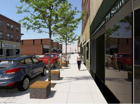 des éléments du paysage de rue, y compris les arbres le long de la rue Elgin.