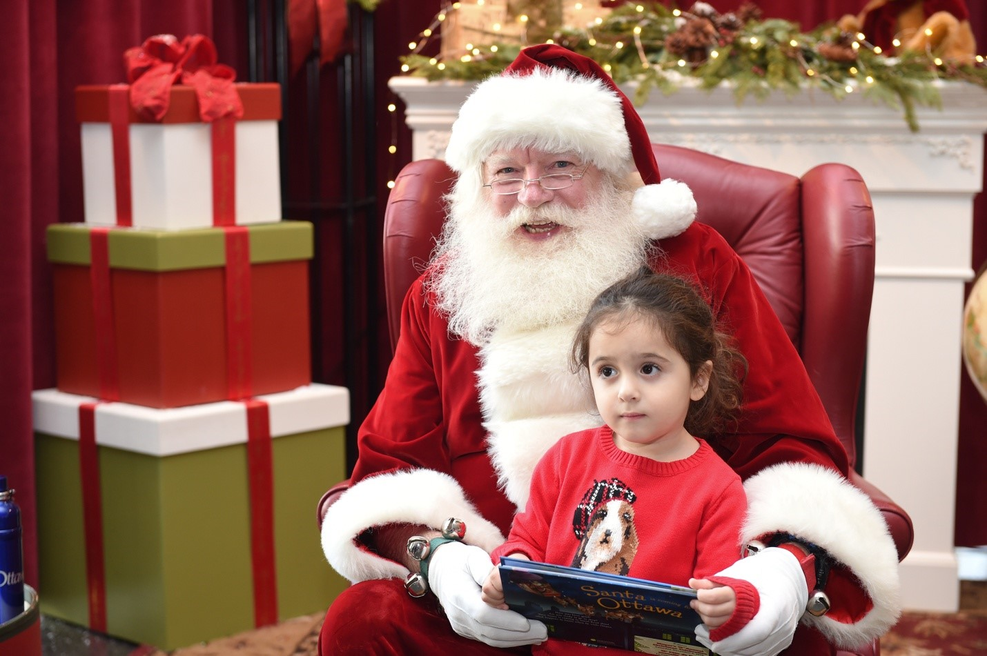 Santa with child sitting on his lap