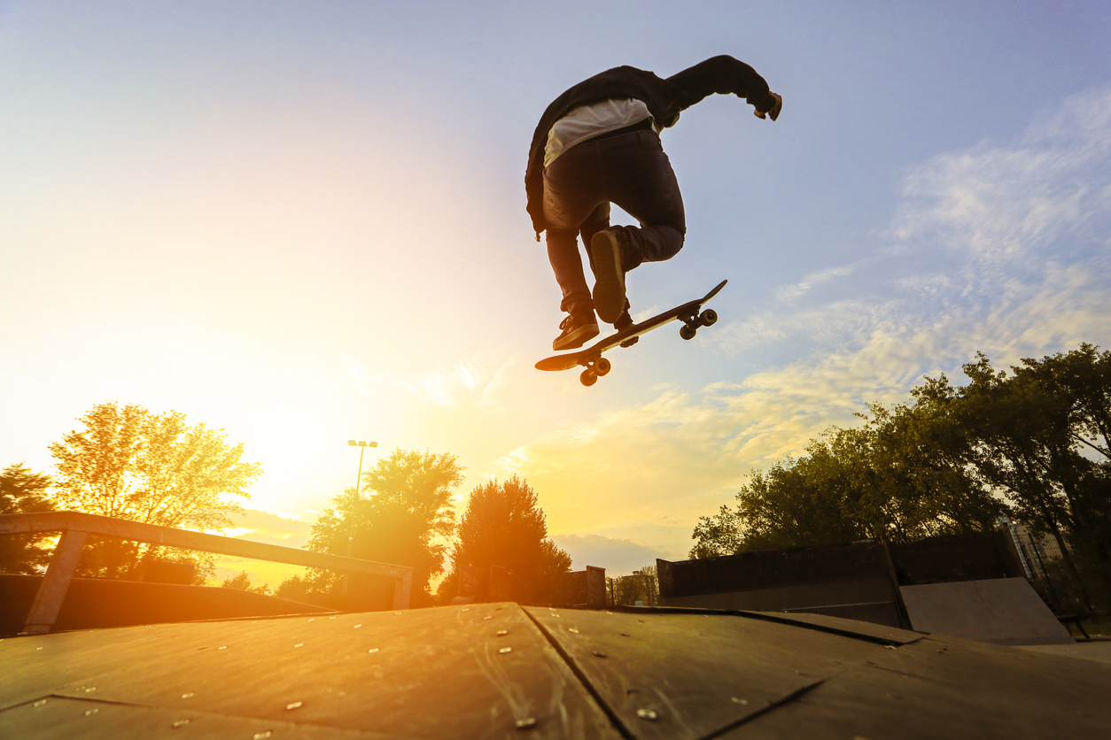 Boy doing skateboard trick.