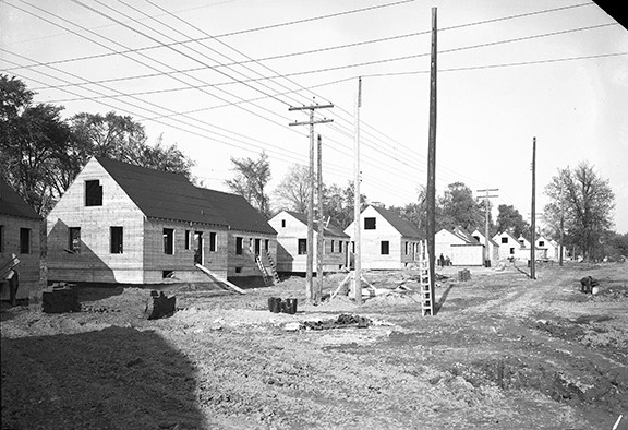 Black and white image of several partially built homes.