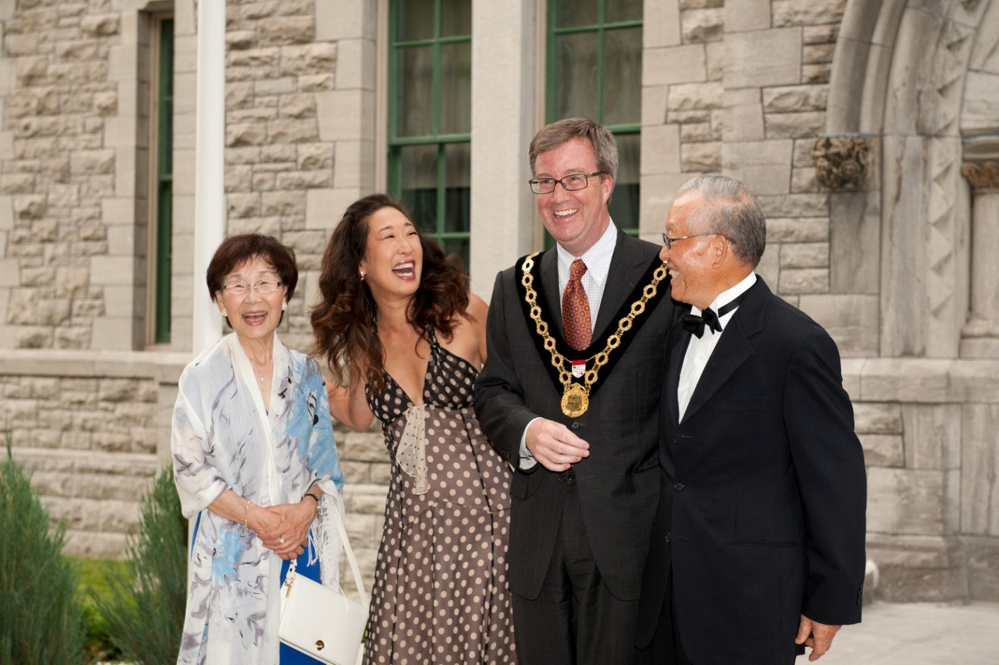 Sandra Oh and parents with Mayor Watson