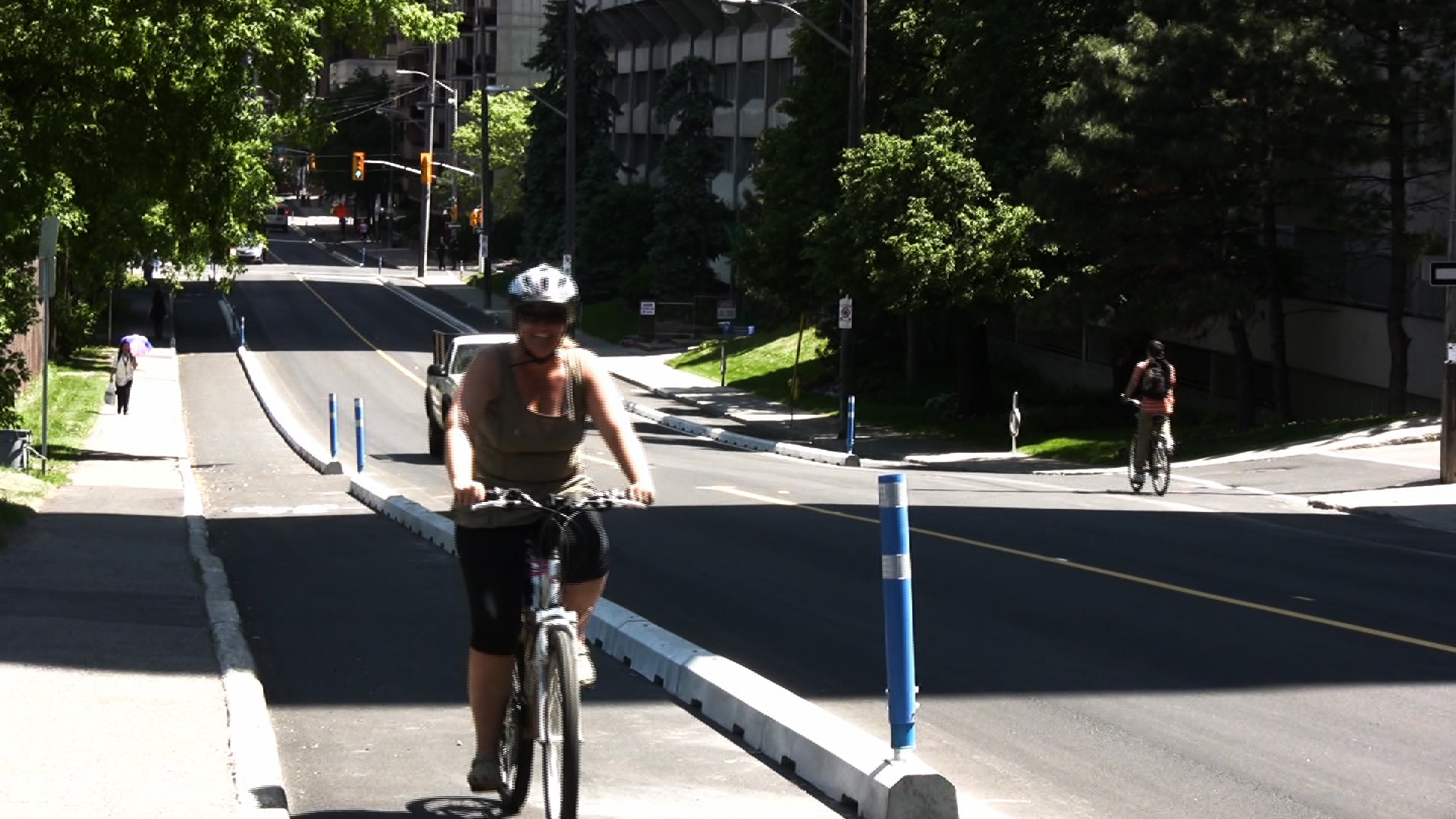 A cyclist using the segregated bike lane on Laurier Avenue