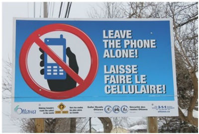 """Leave the Phone Alone"" road sign"