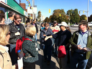 Photograph of community members partaking in a walkabout tour of Main Street.