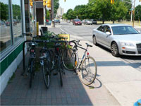 Photograph of bicycle parking outside a business on Main Street.