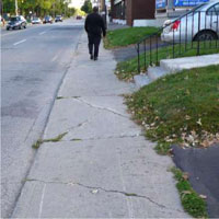 Photograph of existing sidewalk condition on Main Street.  Example of deteriorating conditions.