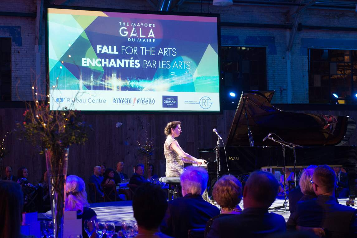 Pianist playing on stage at the Mayor Gala for the Arts