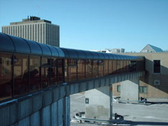 Billings Bridge Plaza is connected to the Transitway by a grade separated pedestrian bridge.