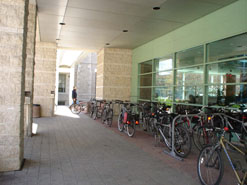 This bicycle parking area at City Hall is protected from the weather by a colonnade and is visible from inside the building.