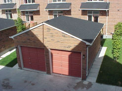 These residential garages are located at the back of the dwellings and are accessible via a private rear lane.