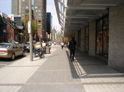 The Place Bell building provides extra wide sidewalks and a building canopy that helps to define the street edge and shelter pedestrians.