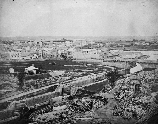 Library and Archives Canada  Samuel McLaughlin /  C-000610  Copyright: Expired   Title: : View towards east from Parliament Hill, Parliament Buildings – Construction, 1861. On mount.  S. McLaughlin Photo: / (Verso:) Lower Town / (Stamp:) D.A. McLaughlin, Photographer to Dept. of Public Works and Railways & Canals  Date: 1861