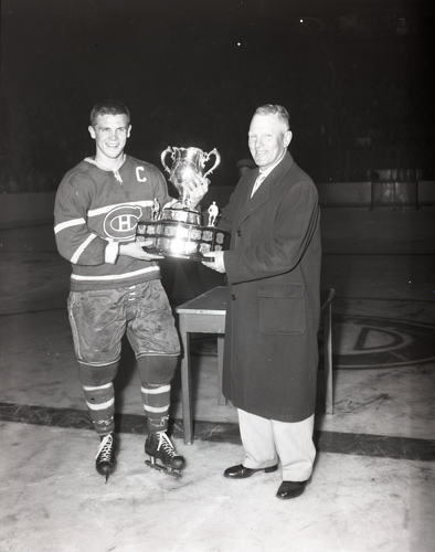 Hull-Ottawa Canadiens celebrate winning the Memorial Cup against Regina. Here is the captain of the team being presented with the trophy.