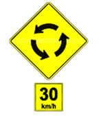Roundabout ahead. Reduce speed to 30 km/h