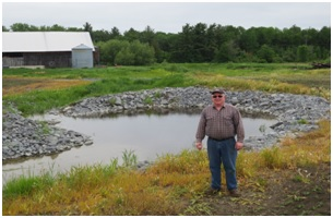 Eastman and one of the completed retention ponds.