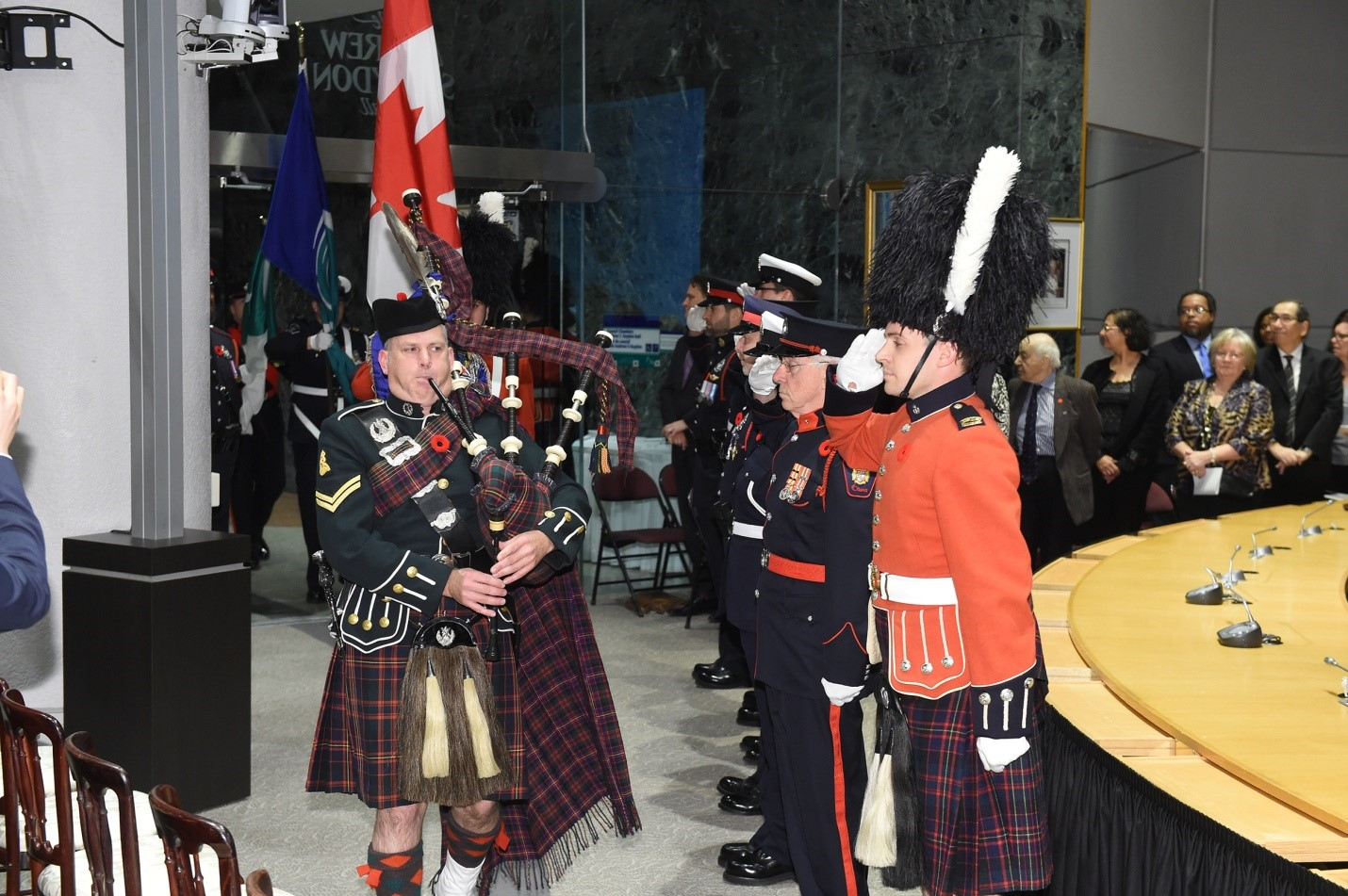 Order of Ottawa ceremony bagpiper escorting in colour party