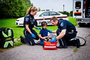 Two Ottawa paramedics treat a child