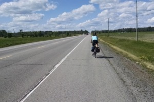 This is an image of a cyclist using a paved shoulder