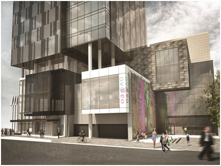 Design Development – 50% Rendering.  View from Daly Avenue of the entrance into the new Ottawa Art Gallery and Arts Court, and the lower levels of the hotel and condominium tower.  The building is composed of the same stacked square and rectangle forms.  The panel with projected images has been moved to an adjacent wall, and large windows have been added facing Daly Avenue. La tour abritant l'hôtel et les logements en copropriété est esquissée dans des matériaux de couleur plus foncée, et la conception des fenêtres et des balcons a été modifiée.