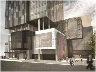 Design Development – 50% Rendering.  View from Daly Avenue of the entrance into the new Ottawa Art Gallery and Arts Court, and the lower levels of the hotel and condominium tower.  The building is composed of the same stacked square and rectangle forms.  The panel with projected images has been moved to an adjacent wall, and large windows have been added facing Daly Avenue.  The hotel and condominium tower is shown in darker coloured materials, and the design of the windows and balconies is adjusted.