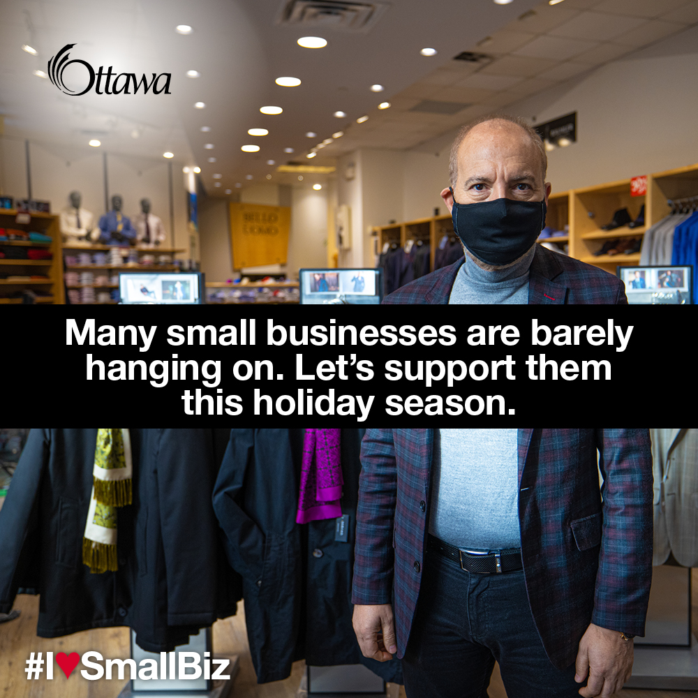 •A man wearing a mask stands in a clothing store. Many small businesses are barely hanging on. Let's support them this holiday season.