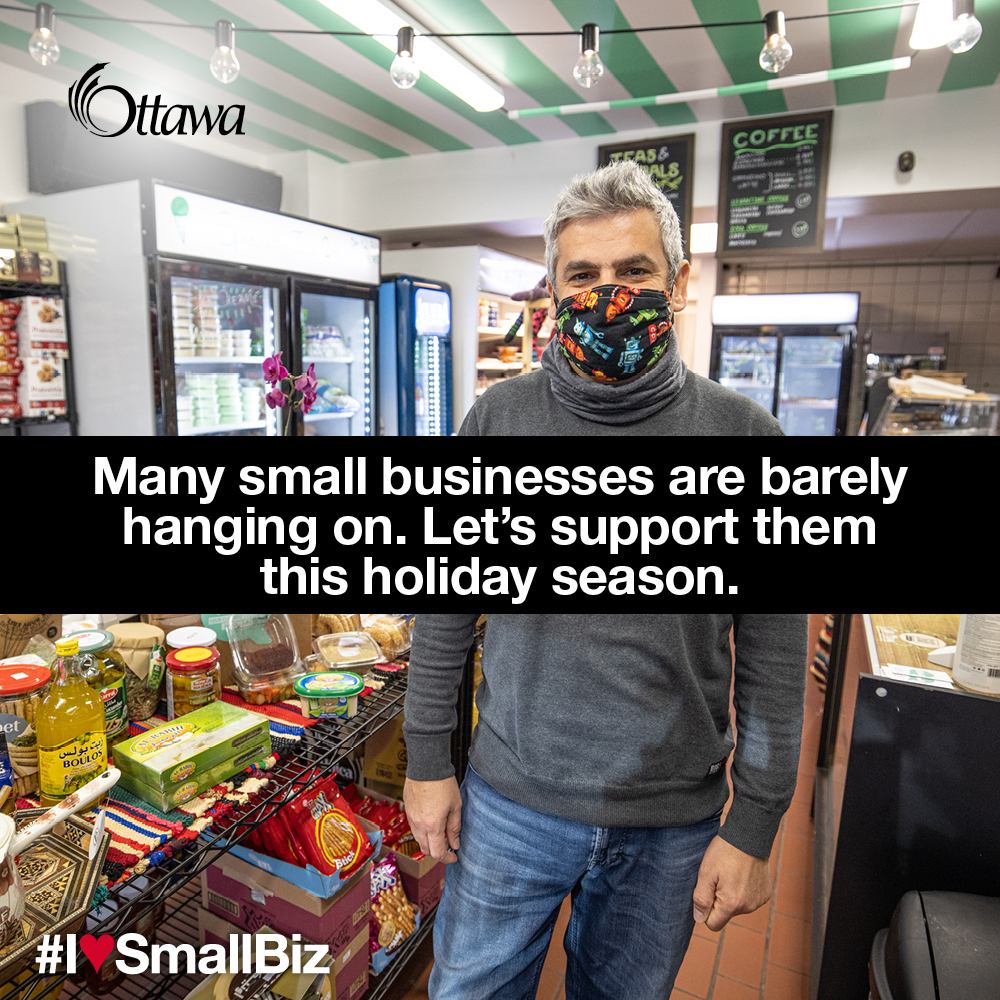 •	A man wearing a mask stands in a deli and convenience store. Many small businesses are barely hanging on. Let's support them this holiday season.