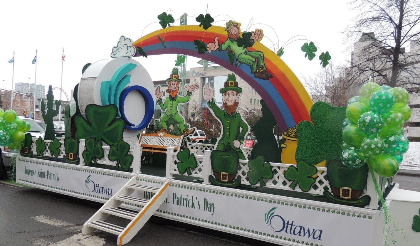 St. Patrick's Day parade float with rainbow and shamrocks